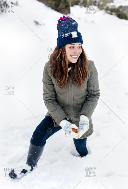 Smiling young woman the snow