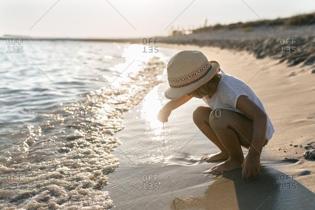Spain - Menorca - little girl playing on the beach