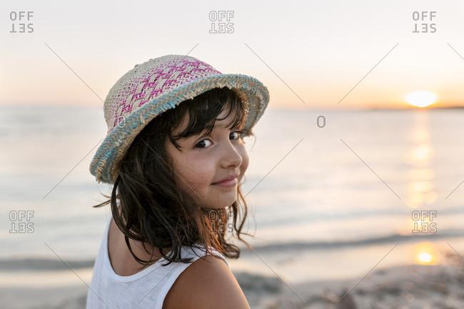 Spain - Menorca - portrait of girl on the beach at sunset