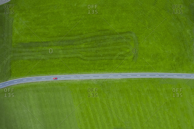 Fire engine driving on country road - aerial view