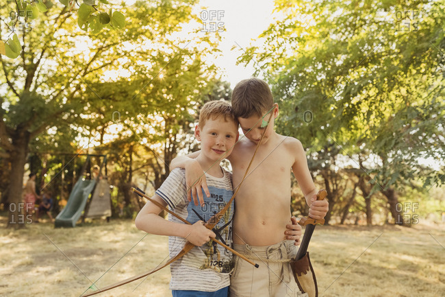 Boys playing with bow and arrows