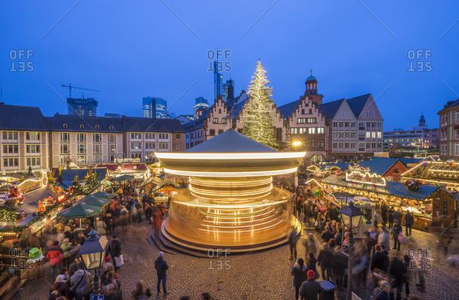 Germany, Frankfurt - December 16, 2016: Rotating carousel on Christmas market at Roemerberg in the evening