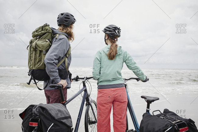Germany - Schleswig-Holstein - St Peter-Ording - couple with bicycles on the beach