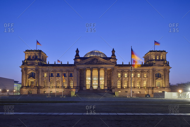 Germany - Berlin - Reichstag building illuminated at dus