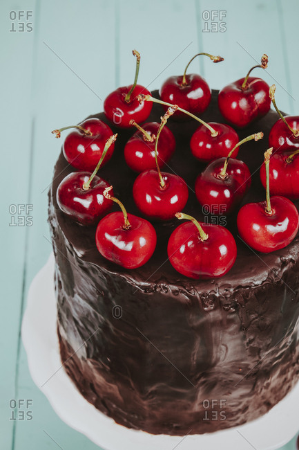 Cherries on cake with chocolate icing