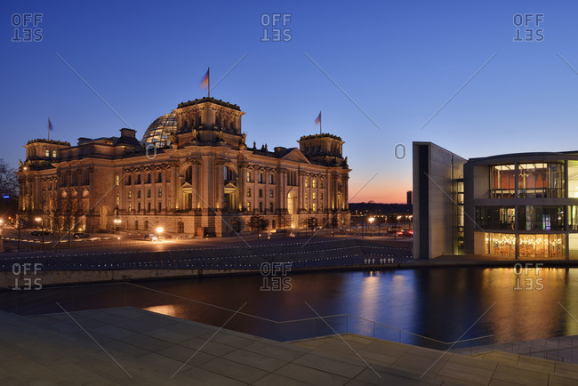 Germany, Berlin - March 11, 2014: Reichstag and Paul Loebe Government Building at Spree river in the evening