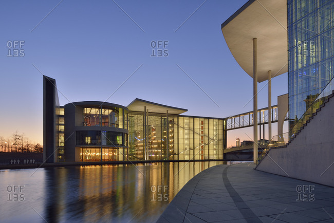 Germany, Berlin - March 11, 2014: Paul Loebe Government Building at Spree river in the evening