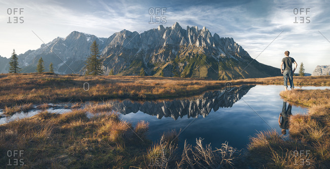 Austria - Hochkoenig - Mandlwand and man standing at moor pond
