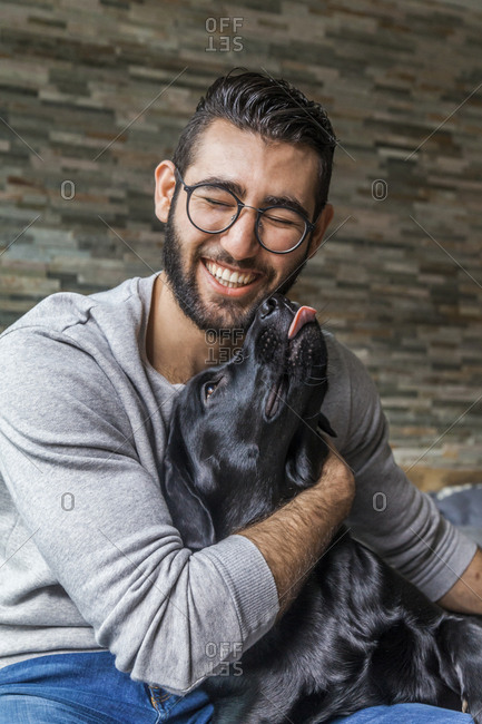 Portrait of man with his dog at home