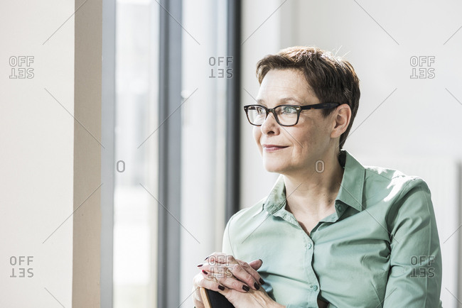 Confident businesswoman with glasses looking sideways