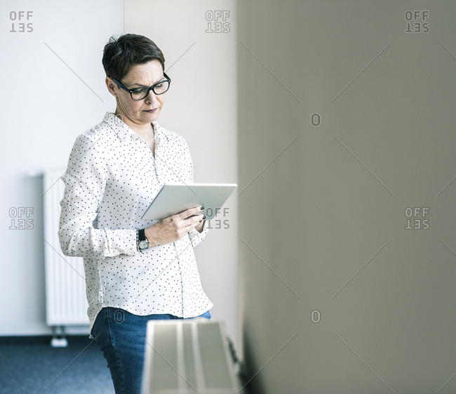 Businesswoman in office looking at tablet