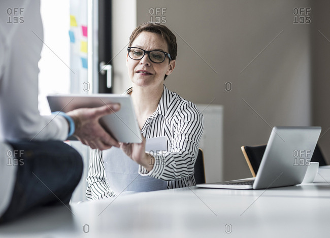 Businesswoman and businessman working in conference room