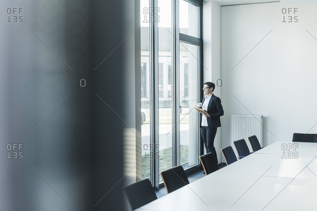 Businesswoman looking out of office window