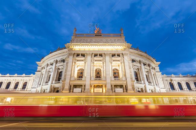 Austria, Vienna - July 26, 2016: Burgtheater - ring road - tram at night