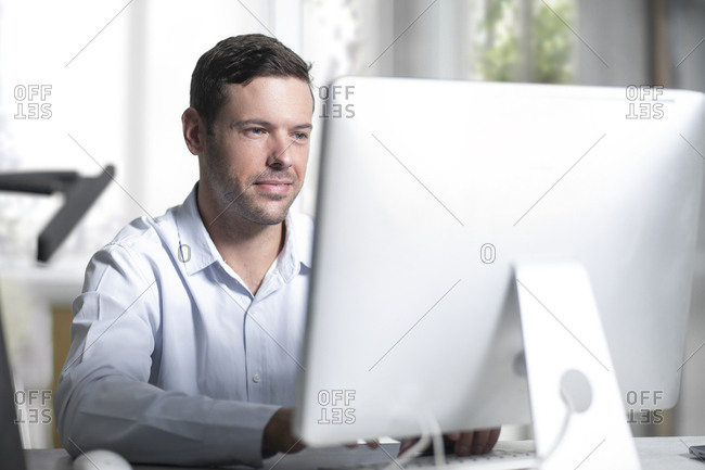 Mid adult businessman working in office