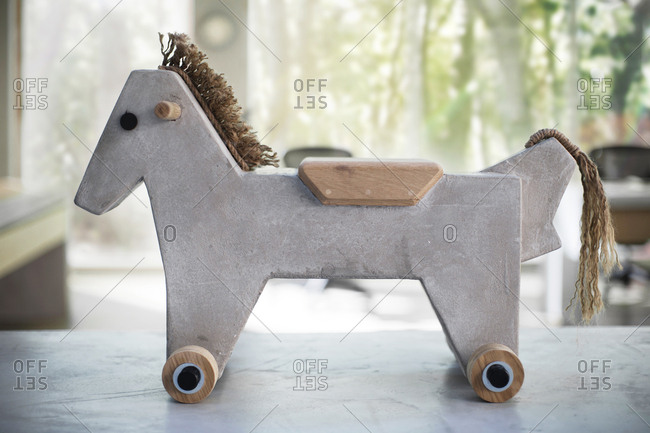 Light concrete toy horse - product design sample