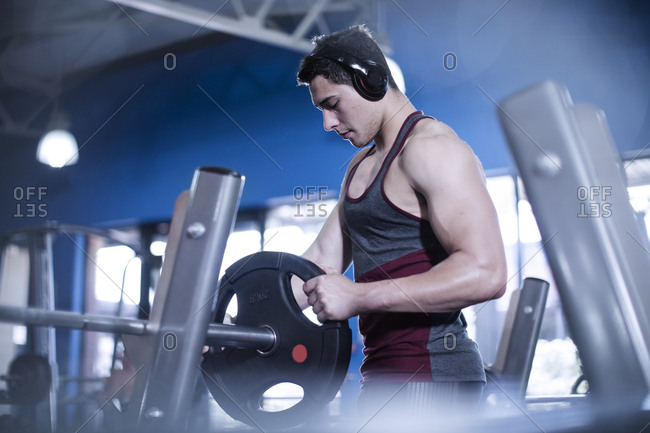 Athletic man preparing for bench press workout