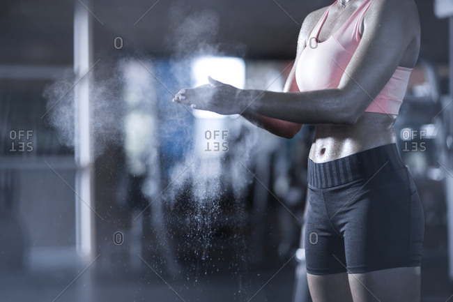 Athletic woman preparing for workout in gym