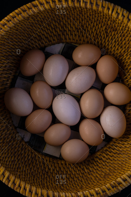 A bamboo basket of chicken eggs
