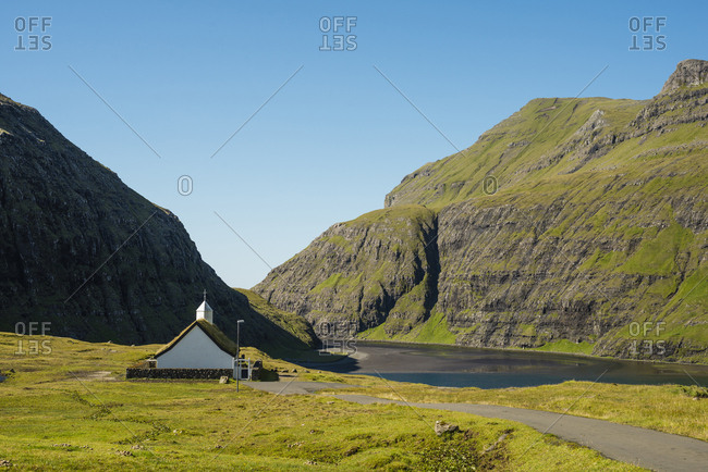 Small church in mountains by lake