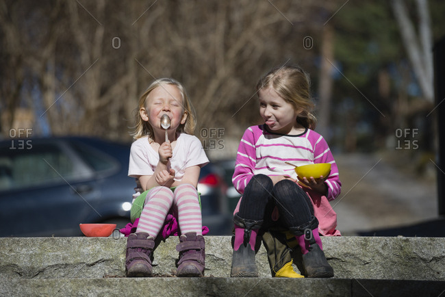 Girls sitting on wall