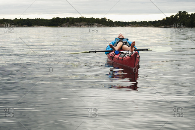 Woman lying on kayak