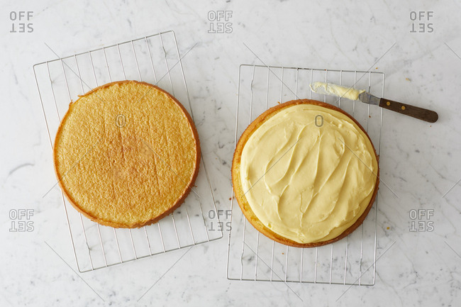 Overhead view of cake being filled with cream
