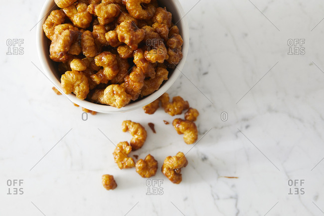 Overhead view of caramel corn puffs in bowl