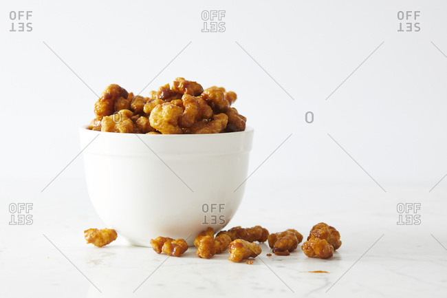 Caramel coated puffed corn snack in bowl