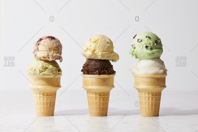 Three ice cream cones with double scoops of ice cream