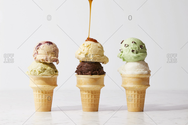 Caramel being poured on ice cream cone
