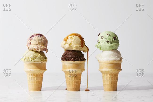 Caramel dripping off ice cream cone