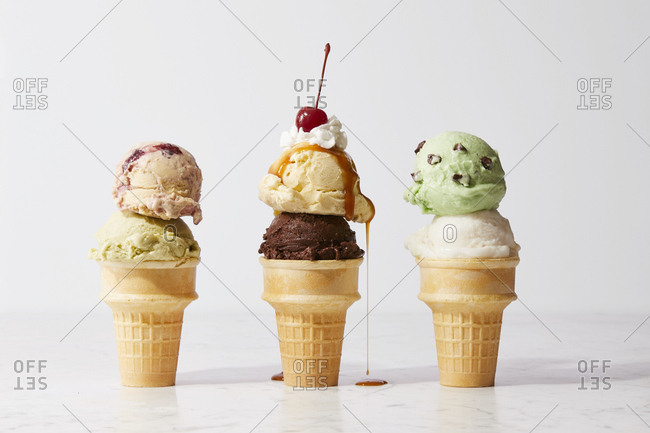 Ice cream cones with caramel, whipped cream, and cherry