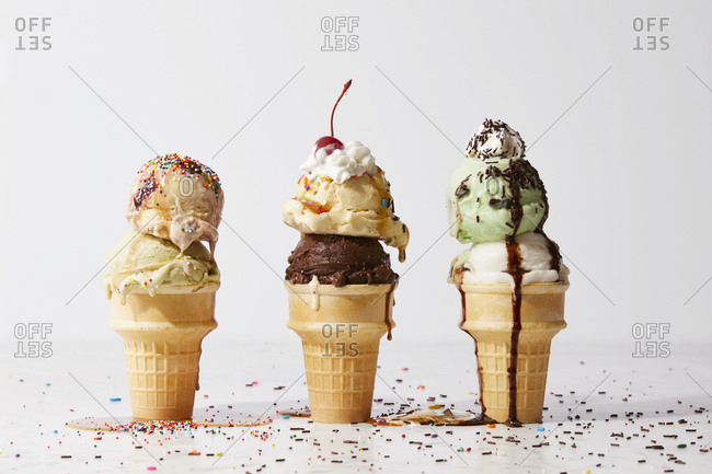 Ice cream cones with sprinkles and other toppings