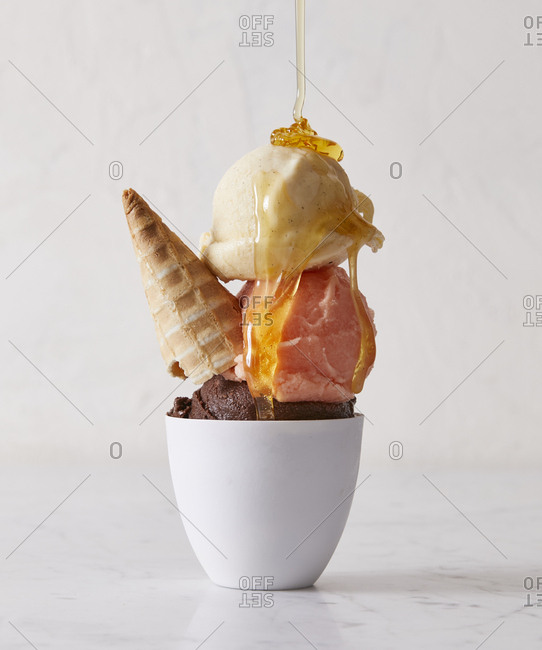 Honey being poured over ice cream