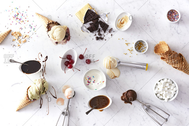 Ice cream and toppings arranged on marble counter