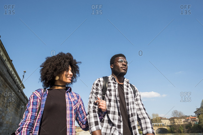 Low angle view of couple walking in city