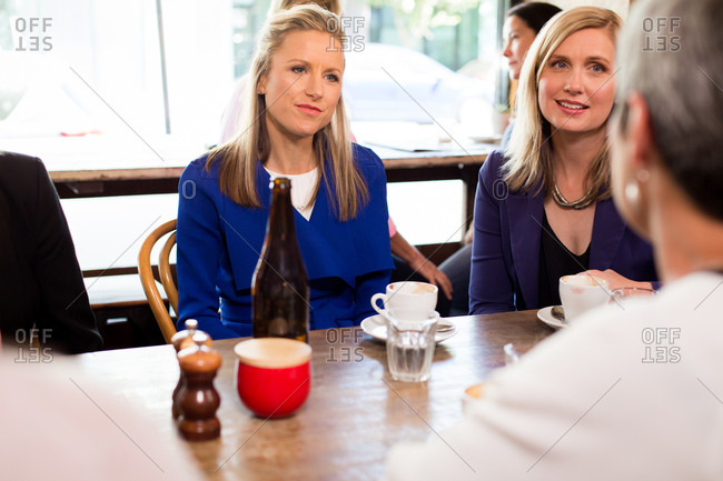 Women having conversation at coffee shop