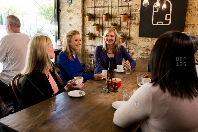 Professional women meeting together at coffee shop
