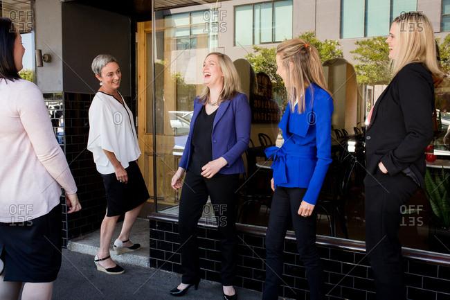 Women standing in front of restaurant