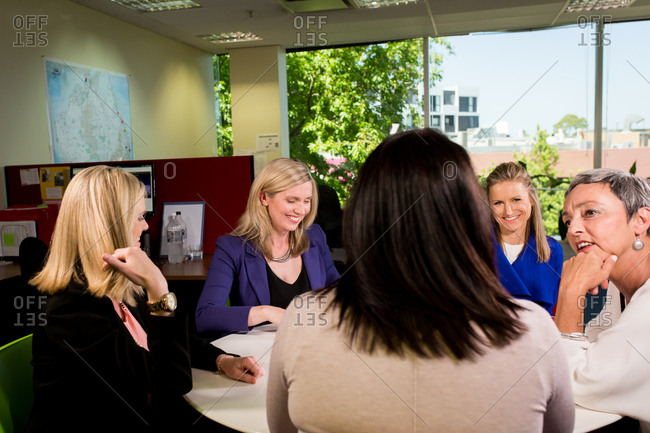 Businesswomen meeting around conference table