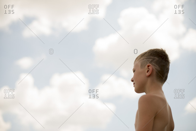 Boy outside with pattern in hair