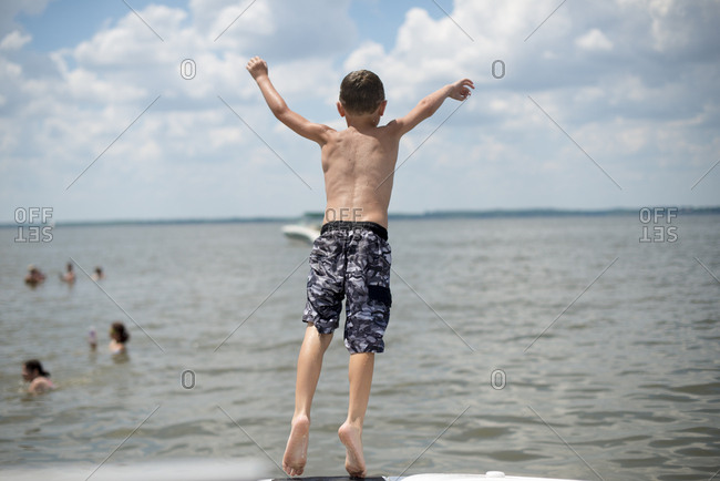 Boy falling into summer lake