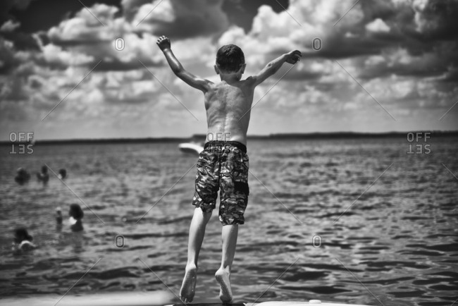 Boy falling into a summer lake