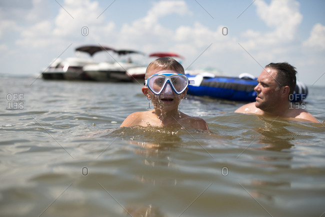 Boy with snorkel mask in lake