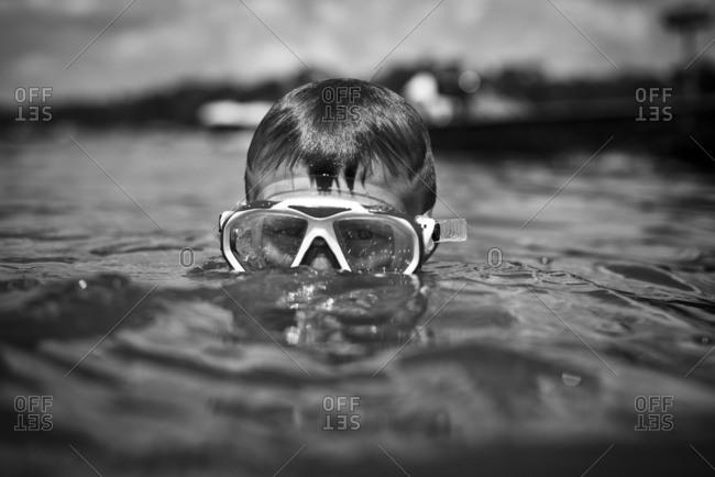 Boy in lake wearing snorkel mask
