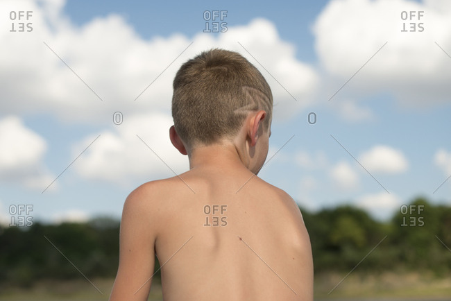 Boy with pattern in hair at lake