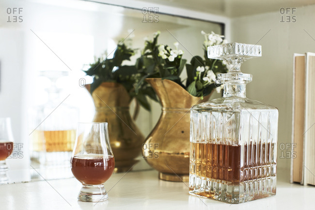 Decanter and glass on shelf
