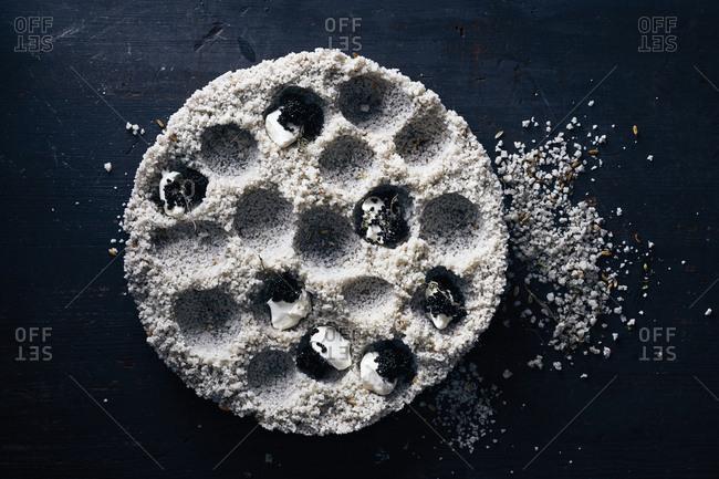 Caviar and crema in salt mounds