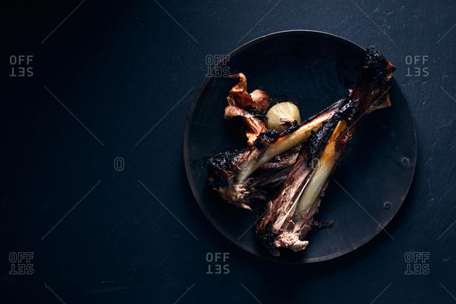 Lamb bones on plate